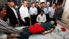 Sam Rainsy (centre left), president of the opposition Cambodia National Rescue Party (CNRP), and his vice president Kem Sokha (centre right), visit injured workers at a hospital in Phnom Penh today. Photograph: EPA