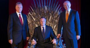 Peter Robinson, First Minister of Northern Ireland; John Hartnett, President, Irish Technology Leadership Group; and Martin McGuiness, Deputy First Minister of Northern Ireland, posing with the throne from the television series, Game of Thrones