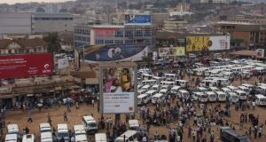 A taxi parking lot in dowtown Kampala, the sprawling capital of Uganda. Photograph: Michele Sibiloni/The New York Times