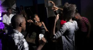 A house party at the Tilapia Cultural Center in Kampala, Uganda. Photograph: Michele Sibiloni/The New York Times
