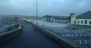 Damage to the Lahinch promenade in Co Clare which is to remain closed to the public until further notice after the walkways and seawall were 'seriously comprised'. Photograph: Mark Flynn