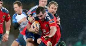 Munster's James Cronin tackled by Fionn Carr last weekend. Photograph: Dan Sheridan/Inpho