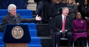 Bill Clinton introduces newly elected mayor Bill de Blasio and his wife, Chirlane McCray, at City Hall in New York on New Year's Day. Photograph: Reuters