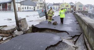 The scene of destruction at Lahinch promenade, west Clare, where massive walls and quarter-tonne wall cappings were tossed across the carpark during the storm. Photograph: Press 22
