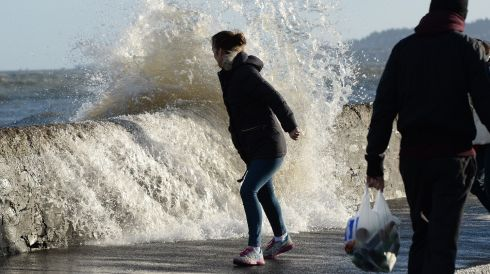 The scene at high tide on Sandymount's coast road in Dublin. Photograph: Cyril Byrne/Irish Times