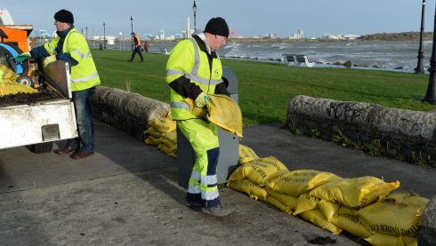 Dublin City Council prepares for the high tides off Sandyount. Photograph: Cyril Byrne/Irish Times