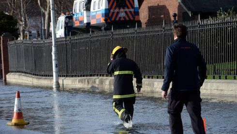 Civil Defense personnell checking  the flooded area of Wolf Tone Quay in Dublin due to the Liffey's high tide. Photograph: Brenda Fitzsimons/ Irish Times