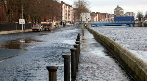 Wolfe Tone Quay in Dublin which was closed due to water overflowing from the Liffey. Photo: Gareth Chaney/Collins