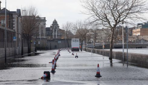 Victoria Quay in Dublin which was closed due to water overflowing from the Liffey. Photograph: Gareth Chaney/Collins