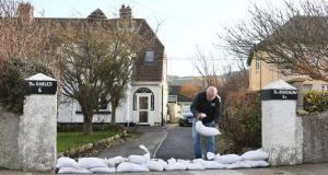 A homeowner sandbags his home in Sutton, Co Dublin this afternoon due to high tide and high winds. Cork homeowners and businesspeople along the South Mall and Oliver Plunkett Street as well as connecting side streets such as Princes Street, Cook Street, Marlborough Street and Pembroke Street had been keeping  sandbags at the ready for tonight.  Photograph: Colin Keegan/Collins