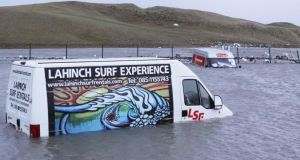 Two vans lie in several feet of water in the promenade carpark at Lahinch in Co Clare. Photograph: Press 22