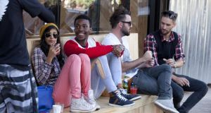 People of different races sit outside a popular coffee shop in Johannesburg. Photograph:  Melanie Stetson Freeman/Getty Images