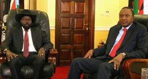 South Sudan's president Salva Kiir (left)  meets with Kenya's  P president Uhuru Kenyatta during peace talks in the capital, Juba. Photograph: Hakim George/Reuters