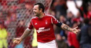 Andy Reid celebrates scoring Forest's fifth goal at the City Ground yesterday. Photograph: John walton/PA.