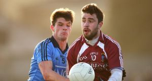 Eric Lowndes challenges Westmeath's Paul Sharry during the O'Byrne Cup clash at Mullingar. Photo: Cathal Noonan/Inpho
