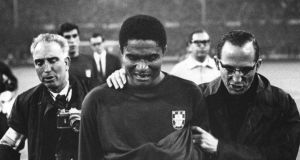 A file image of Eusebio leaving the pitch in tears after Portugal lost the 1966 World Cup semi final 2-1 to England.  Photograph: Getty