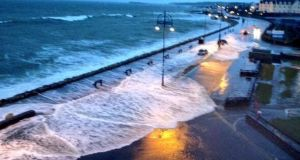 The sea breaks onto the promenade at Salthill this morning. Photograph: Paul O'Brien/Western House/@paulgaillimh