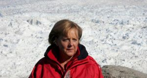 File image of German chancellor Angela Merkel at the Eqi Glacier near Ilulissat, Greenland, in 2007. Dr Merkel has fractured her pelvis in a cross-country skiing accident. Photograph: Michael Kappeler/Reuters