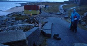 Inspecting the damage to a sea wall at Carraroe, Co Galway. Photograph: Mark Lydon