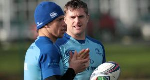 Jamie Heaslip and Zane Kirchner (left) chat during training at UCD on Monday morning. Photograph: Morgan Treacy/Inpho