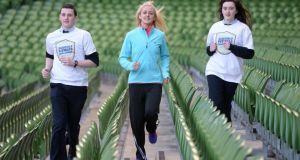 Sarah Lavin, National Junior Athlete of the Year 2013 (centre), with Adam Sheehan and Cliona Sullivan, both students from Oaklands Community College, Edenderry, Co Offaly, at the launch of the Aviva Health Insurance Schools fitness challenge yesterday. Photograph: Dara Mac Dónaill