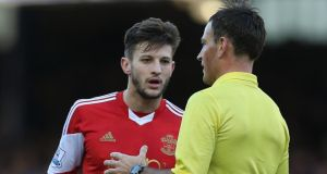 Adam Lallana of Southampton is spoken to by referee Mark Clattenburg during the Barclays Premier League match between Everton and Southampton at Goodison Park on December 29th. Photograph:  Clive Brunskill/Getty Images