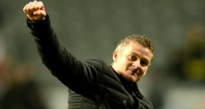 Cardiff manager Ole Gunnar Solskjaer salutes  fans following their team's 2-1 victory over Newcastle United in the  FA Cup third round. Photograph:  Mark Runnacles/Getty Images