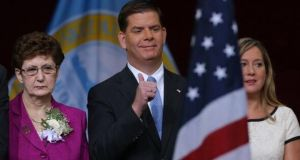 Marty Walsh pictured with his mother Mary (L) after he was sworn in as mayor of Boston today.