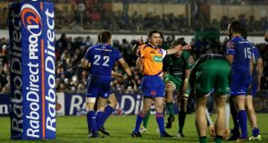 Referee George Clancy checks with the TMO before awarding Gordon D'Arcy's  try against Connacht. Photograph: James Crombie/Inpho