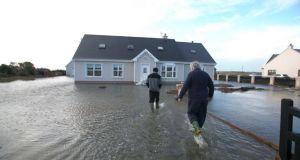 A house is flooded after  the sea crashed into their homes in Quilty Co Clare. Photograph:  Brian Gavin/Press 22