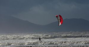 Kite Surfer Lucas Machowski, Killarney during the gale force winds and high spring tide on Inch Strand, Co Kerry. Photograph: Valerie O'Sullivan