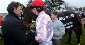 Bryan Cooper speaks to trainer Paul Nolan after winning on King Vuvuzela at Leopardstown. The Co Kerry jockey had his first winner, Toner D'Oudairies, as first jockey to Gigginstown Stud at Thurles.