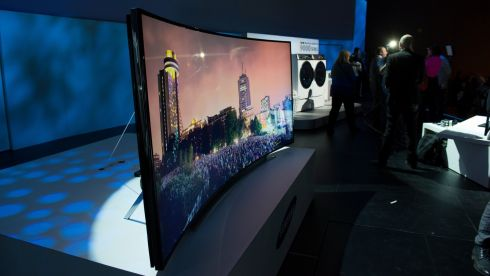 The Samsung Electronics curved ultra high definition (UHD) television stands on display  at CES in Las Vegas. At the show, Samsung outlined plans to sell televisions with bendable screens. Photo: David Paul Morris/Bloomberg