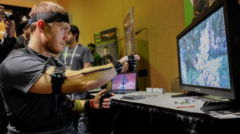 An exhibitor demonstrates a YEI Technology PrioVR game suit at CES in Las Vegas, Nevada.