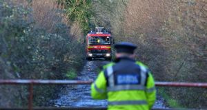 Firefighters pictured at the scene in Kilbride, near Clara, Co Offaly where the body of a man was discovered this morning in an open drain. Photograph: Colin Keegan/Collins.