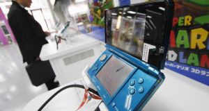 Gaming company Nintendo jumped 11 per cent in Tokyo after China lifted a 13-year ban on game consoles. Photograph: Toru Hanai/Reuters