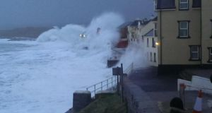 Waves crash into Lahinch Promenade in Co Clare this morning. Photograph: Cliodhna Fawl/Lahinch Surf Shop