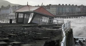 Storm damage is seen on the promenade at Aberystwyth mid Wales yesterday. Photograph: Rebecca Naden/Reuters