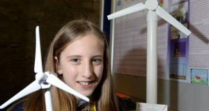 Megan Addie Douglas, Oaklands Community College, Offaly, with her project, Do Wind Turbines Affect People, Animals, or the Environment? at the BT Young Scientist and Technology exhibition at the RDS today. Photograph: Eric Luke/The Irish Times