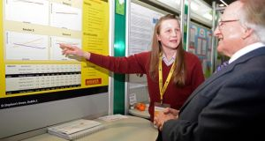 "Kate Madden,  Loreto College St Stephen's Green, explains her project ""Will Eating a Mars Bar increase the Average Speed of a Galloping Pony ?""  to President Higgins, at the opening of the BT Young Scientist & Technology exhibition at the RDS today. Photograph: Eric Luke/The Irish Times"