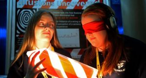 "Siobhan Moore (left) and Clare Lawlor from Saint Dominic's Secondary School, Ballyfermot, Dublin, with their project ""Illusions Uncovered"" , at the BT Young Scientist & Technology exhibition at the RDS, today. Photograph: Eric Luke/The Irish Times"