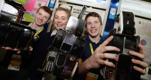 Declan Gleeson, Roisin McDonnell and Conor Sheehan, from Pobalscoil na Tríonóide, Cork with their project - Electro Smog... Will it Stop you Sleeping Like a Log? at the 50th BT Young Scientist & Technology Exhibition at the RDS today. Photograph: Alan Betson/The Irish Times