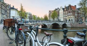 Cycle around Amsterdam and take in its fantastic art galleries, museums, flower markets and traditional cafe bars