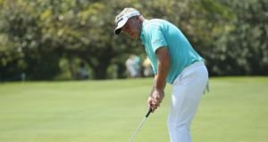 Darren Clarke hits a putt during the first round of the Volvo Golf Champions. Photograph: Ian Walton/Getty Images