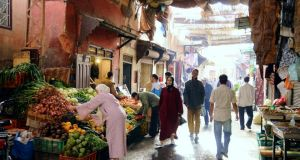 Shopping for supplies in the souk at the Medina of Marrakesh in  Morocco. Photogaph: Getty