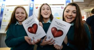 "Kirsten Daly, Rachel Mulvihill and Deirdre Neavyn, from Mount Anville secondary school, with their project ""Does a broken heart really exist?"" Photograph: Alan Betson"