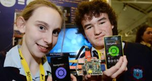Fionnuala Connolly and Ben Nolan, from St Colmcille's Community School, show their Mediavista Connect, which enables a smartphone-controlled TV media centre, at the 50th BT Young Scientist & Technology Exhibition at the RDS. Photograph: Alan Betson