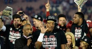 Quarterback Jameis Winston of the Florida State Seminoles celebrates after his last minute heroics helped his side defeat the Auburn Tigers 34-31 in the 2014  BCS National Championship game. Photograph: Harry How/Getty Images