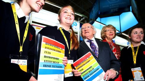 President Michael D Higgins and his wife Sabina with students from Beara Community School, Co Cork, who conducted an investigation into homophobic attitudes in Irish teenagers, at the official opening of the BT Young Scientist & Technology Exhibition at the RDS in Dublin. Photograph: Brian Lawless/PA Wire