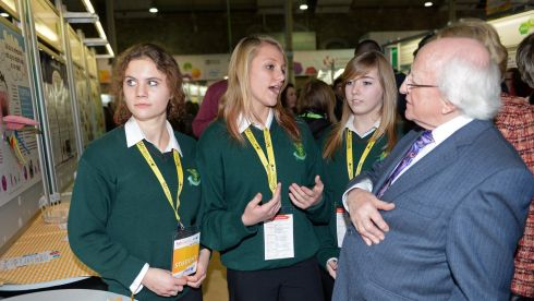Fiona Lawless,  Sadie McGrath, and Amy Tynan, Scoil Ruain, Tipperary, explaining their project, Bees - A Dying Race, to President Higgins at the opening of  the BT Young Scientist & Technology exhibition. Photograph:  Eric Luke/The Irish Times